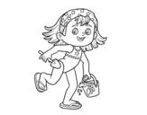 Disegno di Bambina con la spiaggia secchiello e paletta da colorare