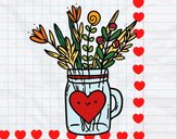 Pot con i fiori selvatici e un cuore